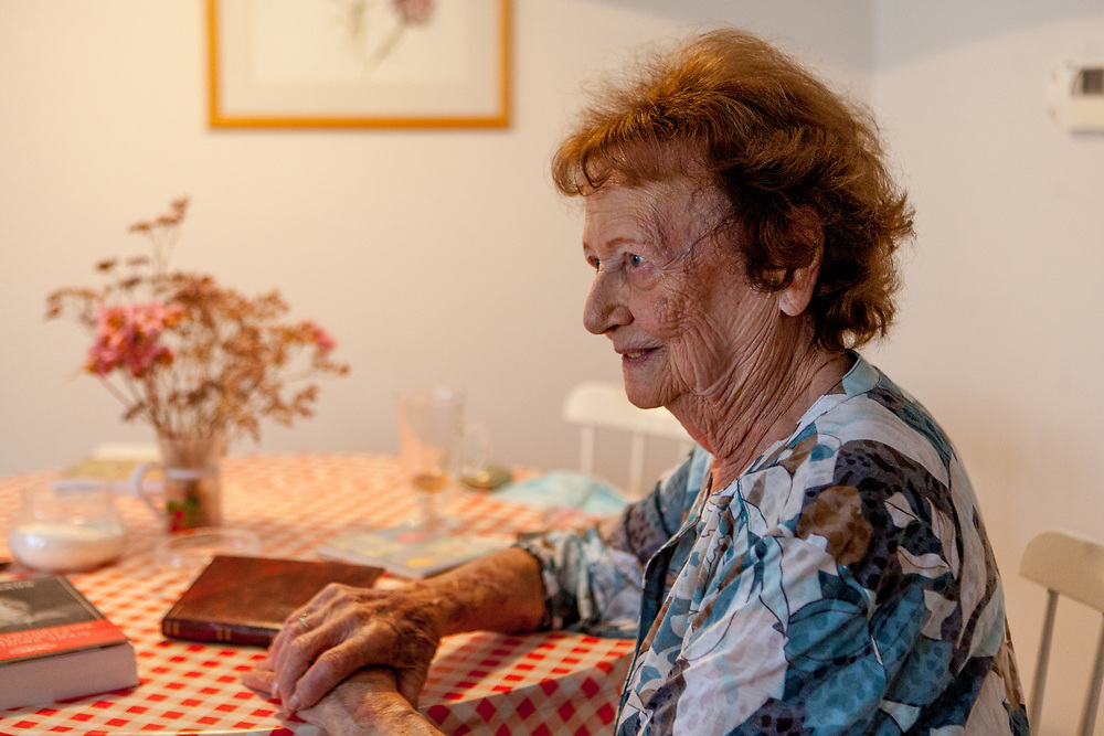 """Dita Kraus in her flat in Prague Vinohrady. Born in Prague to a Jewish family in 1929, Dita Kraus has lived through the most turbulent decades of the twentieth and early twenty-first centuries. Here, Dita writes in her book """"A Delayed Life: The true story of the Librarian of Auschwitz"""" with startling clarity on the horrors and joys of a life delayed by the Holocaust. From her earliest memories and childhood friendships in Prague before the war, to the Nazi-occupation that saw her and her family sent to the Jewish ghetto at Terezín, to the unimaginable fear and bravery of her imprisonment in Auschwitz and Bergen-Belsen, and life after liberation."""