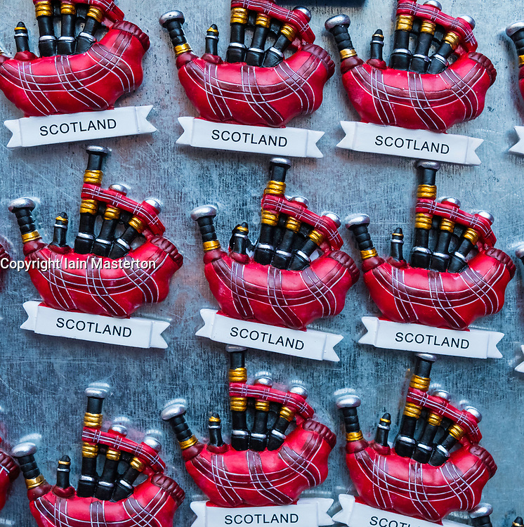 Tourist fridge magnets with Scottish bagpipes for sale in tourist souvenir shop in Edinburgh, Scotland, United Kingdom.