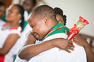 New pastor Frank Mdindi is congratulated after his ordination on Sunday, March 15, 2015, at the Evangelical Lutheran Church in Tanzania – South-East of Lake Victoria Diocese's (ELCT-SELVD) Ebenezer Cathedral in Shinyanga, Tanzania. LCMS Communications/Erik M. Lunsford