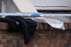 © Licensed to London News Pictures. 22/09/2018. London, UK. An evidence bag on the wall of a property on Wilderton Road, Stamford Hill, North London where a man in his 20's was found stabbed to death following a fight at a flat. A second victim , a 17-year-old male , was also taken to hospital suffering a stab injury. A murder investigation has bene launched. Photo credit: Ben Cawthra/LNP