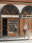 A man sweeps outside his shop, early in the morning on Straight Street, Damascus, Syria