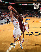 Nov 6, 2010; Charlottesville, VA, USA; Virginia Cavaliers f Will Regan (4) grabs the rebound Saturday afternoon in exhibition action at John Paul Jones Arena. The Virginia men's basketball team recorded an 82-50 victory over Roanoke College.