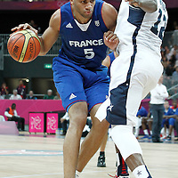 29 July 2012: USA James Harden defends on Nicolas Batum of France during the 98-71 Team USA victory over Team France, during the men's basketball preliminary, at the Basketball Arena, in London, Great Britain.