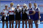 © Peter Spurrier/Sports Photo .email pictures@rowingpics.com tel +44 7973 819 551.Photo  Peter Spurrier.30/08/2003 Saturday.2003 World Rowing Championships, Idroscala. Milan, Italy.  {A Finals] .Left to right W2X Medallist - Left GER W2X Silver medallist Bitta Oppler and Katrin Boren, Centre Gold medallist NZ W2X Caroline and Georgina Evers-Swindell, Right Bronze medallist RUS W2X  Laris Merk and Irina Fedotova . Milan. ITALY 2003 World Rowing Championships. Idro Scala Rowing Course. [Mandatory Credit: Peter Spurrier: Intersport Images.]