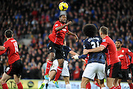 Kevin Theophile Catherine beats Jonny Evans of Manchester United to the ball.<br /> Barclays Premier League match, Cardiff city v Manchester Utd at the Cardiff city stadium in Cardiff, South Wales on Sunday 24th Nov 2013. pic by Phil Rees, Andrew Orchard sports photography,