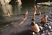 Nude bathers.  Base Camp at Redwood Summer, a conglomeration of environmental activists who camped out near Willow Creek, California, USA, to protest excessive logging during the summer of 1990.