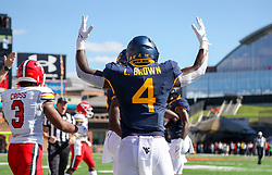Sep 4, 2021; College Park, Maryland, USA; West Virginia Mountaineers running back Leddie Brown (4) celebrates after a touchdown during the first quarter against the Maryland Terrapins at Capital One Field at Maryland Stadium. Mandatory Credit: Ben Queen-USA TODAY Sports