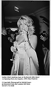 Amber Dikel smoking cigar at the Beverly Hills Hotel <br />re-Opening Party. los Angeles. 1995. Film 95269/21<br /><br />© Copyright Photograph by Dafydd Jones<br />66 Stockwell Park Rd. London SW9 0DA<br />Tel 0171 733 0108