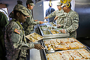 Soldiers get their meals from an officers' mess at Fort Irwin, California, in the Mojave Desert.
