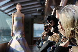 """Guests taking pictures during the Jessica Minh Anh's """"Catwalk On Water"""" Winter Fashion Show 2017 held on Bateaux Mouches' Le Jean Bruel on The Seine River in Paris on Thursday January 26, 2017"""