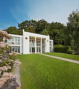 green garden of a white modern villa, external