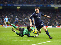 11/12/2004 - FA Barclays Premiership - Manchester City v Tottenham Hotspur - The City of Manchester Stadium.<br />Tottenham Hotspur's Robbie Keane gets around Manchester City's diving goalkeeper David James, but fails to get his shot on target.<br />Photo:Jed Leicester/Back Page Images