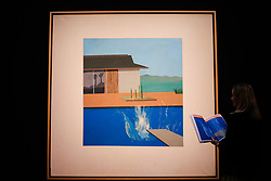 © Licensed to London News Pictures. 07/02/2020. London, UK. A staff member views David Hockney's painting titled 'The Splash' (Est. £20-£30 million) at the preview of Sotheby's Contemporary Art. The auction will take place at Sotheby's in central London on 11 and 12 February 2020. Photo credit: Dinendra Haria/LNP