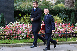 Downing Street, London, October 18th 2016. Health Secretary Jeremy Hunt, left, and Welsh Secretary Alun Cairns arrive at the weekly cabinet meeting at 10 Downing Street in London.