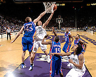 Kansas State University -- Kansas State Wildcats forward Michael Beasley (30) drives to the basket against pressure from Kansas Jayhawks center Cole Aldrich (45) in the first half of the Wildcats upset win over the Jayhawks 84-75 at Bramlage Coliseum in Manhattan, Kansas.