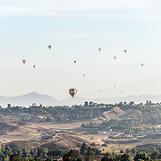 A fleet of hot air balloons float over Temecula in southwest California during the Temecula Wine and Balloon Festival in June 2013.
