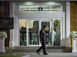 November 3, 2018 - Bangkok, Bangkok, Thailand - A man walks past the room where the Abhidhamma Recitation Ceremony. is being held on the first day of funeral rites for Vichai Srivaddhanaprabha at Wat Debsirin in Bangkok. Vichai was the owner of King Power, a Thai duty free conglomerate, and the Leicester City Club, a British Premier League football (soccer) team. He died in a helicopter crash in the parking lot of the King Power stadium in Leicester after a match on October 27. Vichai was Thailand's 5th richest man. The funeral is expected to last one week. (Credit Image: © Sean Edison/ZUMA Wire)