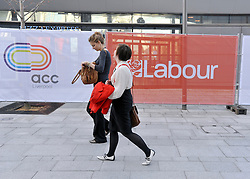 © Licensed to London News Pictures. 27/09/2011. LONDON, UK. Delegates walk past labour party hoardings. The Labour Party Conference in Liverpool today (27/09/11). Photo credit:  Stephen Simpson/LNP