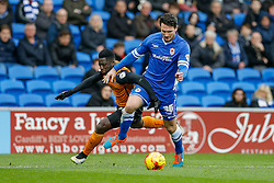 Nouha Dicko of Wolverhampton Wanderers is challenged by Sean Morrison of Cardiff City - Photo mandatory by-line: Rogan Thomson/JMP - 07966 386802 - 28/02/2015 - SPORT - FOOTBALL - Cardiff, Wales - Cardiff City Stadium - Cardiff City v Wolverhampton Wanderers - Sky Bet Championship.