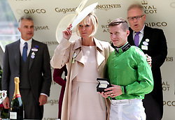 Jockey Richard Kingscote is presented with a medal by Hermione Norris after winning the Chesham Stakes on Arthur Kitt during day five of Royal Ascot at Ascot Racecourse.
