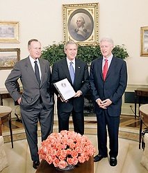 Former President George H.W. Bush, left, and former President Bill Clinton, right meet in the Oval Office to brief President George W. Bush on fundraising for private fundraising efforts for victims of the earthquake and tsunami disasters Tuesday, March 8, 2005 in Washington, D.C. Photo by Chuck Kennedy/KRT/ABACA.