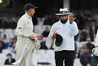 Cricket - 2017 South Africa Tour of England - Third Test, Day Two<br /> <br /> England captain Joe Root is told by the Umpire that its too dark to use fast bowlers, because of bad light during the evening session, at The Oval.<br /> <br /> COLORSPORT/ANDREW COWIE