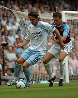 Photo: Tony Oudot. <br /> West Ham United v Manchester City. Barclays Premiership. 11/08/2007. <br /> Rolando Bianchi of Manchester City holds the ball from Matthew Upson of West Ham