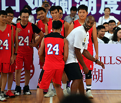 HAIKOU, Sept. 12  Former NBA basketball player Kobe Bryant (1st R, front) attends a basketball teaching activity with young basketball fans in Haikou, capital of south China's Hainan Province, Sept. 12, 2017. (Credit Image: © Guo Cheng/Xinhua via ZUMA Wire)