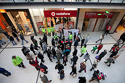 © under license to London News Pictures. 18/12/2010: Approximately 25 protesters picketed Top Shop and other shops associated with Philip Green, Vodafone and Boots to highlight corporate tax-avoidance. Outside Vodafone in Manchester's Arndale Centre, the small protest was watched by many dozens of police and bewildered Christmas shoppers