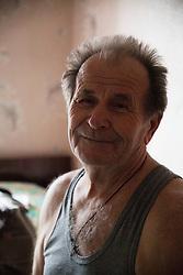 Ivan Vorobyeva, 74, in his apartment in Debaltsevo.