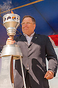 Mayor Donald Atchison places the Saskatoon 100 commemorative torch into its stand at the start of Optimist Centennial Canada Day, Diefenbaker Park, July 1, 2006