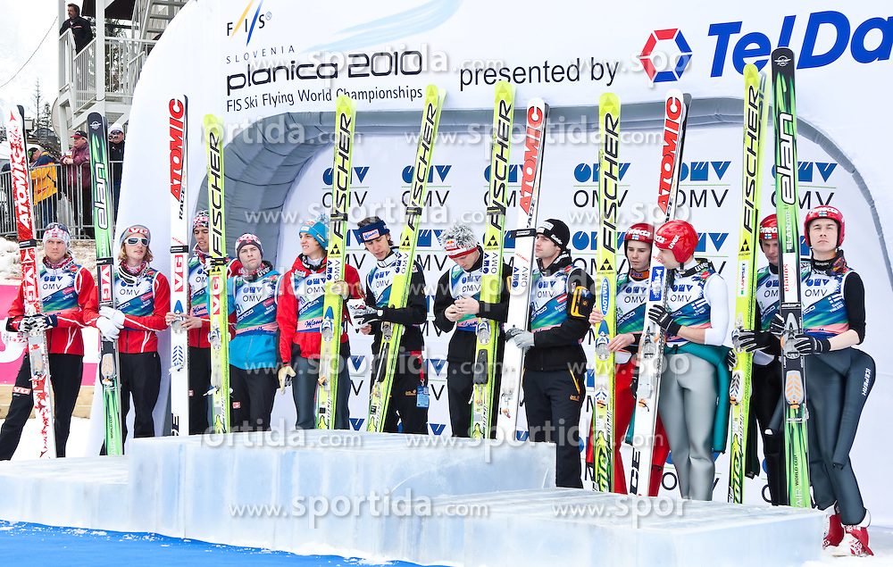 21.03.2010, Planica, Kranjska Gora, SLO, FIS SKI Flying World Championships 2010, Flying Hill Team, im Bild das Podium des Teambewerbs 2010, v.l. ROMOEREN Bjoern Einar, ( NOR ), EVENSEN Johan Remen, ( NOR ), BARDAL Anders, ( NOR ), JACOBSEN Anders, ( NOR ), SCHLIERENZAUER Gregor, ( AUT ), KOCH Martin, ( AUT ), MORGENSTERN Thomas, ( AUT ), LOITZL Wolfgang, ( AUT ), OLLI Harri, ( FIN ), HAUTAMAEKI Matti, ( FIN ), MUOTKA Olli, ( FIN ), HAPPONEN Janne, ( FIN ), EXPA Pictures © 2010, PhotoCredit: EXPA/ J. Groder / SPORTIDA PHOTO AGENCY