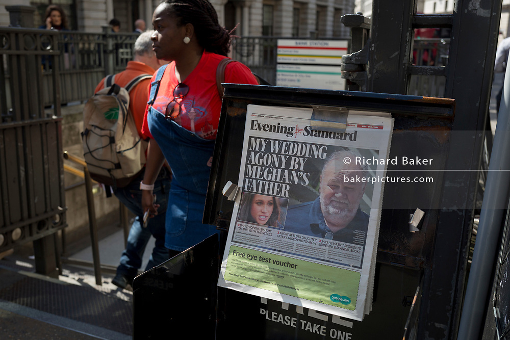 Evening Standard headlines with news of Meghan Markle's father not attending the upcoming royal wedding between the American actor and prince Harry, at Bank underground station in the City of London, the capital's financial district aka the Square Mile, on 15th May 2018, in London, UK.
