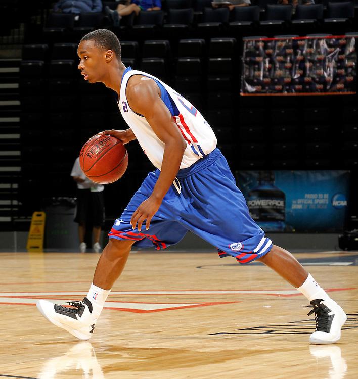 Duane Wilson participates in a basketball camp in Charlottesville, Va. (Photo/Andrew Shurtleff)