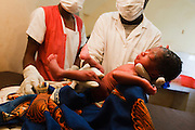 Midwife Josephine Sidibe and Dr. Adama Bouare examine a premature child that was just brought in by his mother after a home delivery at the Kita reference health center in the town of Kita, Mali on Monday August 30, 2010.