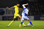 Jake Jervis (10) of AFC Wimbledon is tackled by Liam Sercombe (7) of Bristol Rovers during the EFL Sky Bet League 1 match between Bristol Rovers and AFC Wimbledon at the Memorial Stadium, Bristol, England on 23 October 2018.