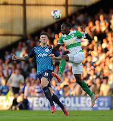 Yeovil Town's Nathan Smith challenges for the high ball with QPR's Ben Gladwin - Photo mandatory by-line: Harry Trump/JMP - Mobile: 07966 386802 - 11/08/15 - SPORT - FOOTBALL - Capital One Cup - First Round - Yeovil Town v QPR - Huish Park, Yeovil, England.