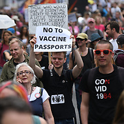 Unite for Freedom no COVID passports protestors holding banners march for freedom against Vaccine Passports in London, on 29th May 2021.