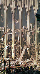 18 Sept 2001. Twin Towers World Trade Center, New York City, NY. 9-11.<br /> Firemen recovery crews at the still smoldering remains of the World Trade Center Twin Towers following a heinous terrorist attack by Al Qaeda operatives. <br /> Photo credit©; Charlie Varley/varleypix.com.