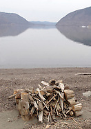 Cornwall, NY - A pile of driftwood stacked on the beach by the Hudson River at Kowawese at Plum Point on March 27, 2008.