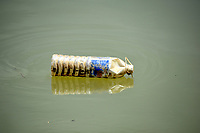 Old plastic bottle just floating in the river