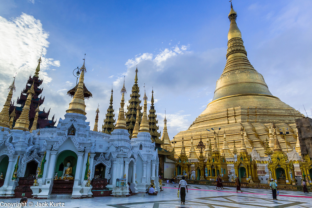 15 JUNE 2013 - YANGON, MYANMAR:  Shwedagon Pagoda is officially known as Shwedagon Zedi Daw and is also called the Great Dagon Pagoda or the Golden Pagoda. It is a 99 metres (325 ft) tall pagoda and stupa located in Yangon, Burma. The pagoda lies to the west of on Singuttara Hill, and dominates the skyline of the city. It is the most sacred Buddhist pagoda in Myanmar and contains relics of the past four Buddhas enshrined: the staff of Kakusandha, the water filter of Koṇāgamana, a piece of the robe of Kassapa and eight strands of hair fromGautama, the historical Buddha. The pagoda was built between the 6th and 10th centuries by the Mon people, who used to dominate the area around what is now Yangon (Rangoon). The pagoda has been renovated numerous times through the centuries. Millions of Burmese and tens of thousands of tourists visit the pagoda every year, which is the most visited site in Yangon.  PHOTO BY JACK KURTZ