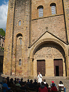 One on the monks of the Sainte Foy Abbey gives a talk on the church, its history and the religion surrounding it. In the late afternoon in Conques many had gathered to hear the talk.
