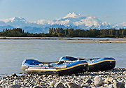 See Mount Hunter and Mount McKinley from the confluence of the Talkeetna and Susitna Rivers at Talkeetna, Alaska, USA. Paddle a rubber raft. Denali (20,310 feet or 6191 meters, aka Mount McKinley) is the highest mountain peak in North America, and measured from base to peak, it is earth's tallest mountain on land. Mount McKinley is a granitic pluton uplifted by tectonic pressure while erosion has simultaneously stripped away the somewhat softer sedimentary rock above and around it.