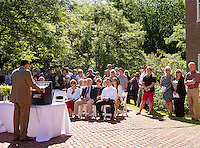 Mayor Ed Engler speaks to the Karagianis family and others gathered at the Belknap Mill for the dedication ceremony of Peter S. Karagianis Way on Thursday morning.  (Karen Bobotas/for the Laconia Daily Sun)