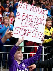 A young fan in the crowds holds up a sign for Stoke City goalkeeper Jack Butland