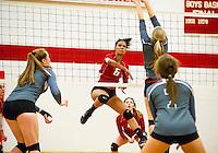 Deyanara (Jani) Ortega powers a shot past Andrea Geri of Kingswood during NHIAA Division II Volleyball Tuesday evening.  (Karen Bobotas/for the Laconia Daily Sun)