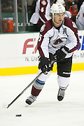 DALLAS, TX - SEPTEMBER 26:  P.A. Parenteau #15 of the Colorado Avalanche controls the puck against the Dallas Stars in an NHL preseason game on September 26, 2013 at the American Airlines Center in Dallas, Texas.  (Photo by Cooper Neill/Getty Images) *** Local Caption *** P.A. Parenteau