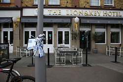 © Licensed to London News Pictures. 05/05/2019. London, UK. A leftover of police tape outside The Lion and Key Hotel Leyton High Road in East London. According to the locals, three men believed to be 23, 28 and 30, suffered gunshot wounds in the shooting just before 9 pm on Saturday 4 May 2019 outside Al Jaziira cafe opposite The Lion and Key Hotel. A 30 year old victim is in critical condition. Photo credit: Dinendra Haria/LNP