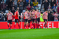 Chris Maguire of Sunderland (7) scores a goal and celebrates with team mates to make the score 1-0 during the EFL Sky Bet League 1 first leg Play Off match between Sunderland and Portsmouth at the Stadium Of Light, Sunderland, England on 11 May 2019.